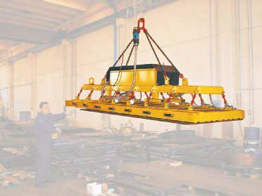 Beam with electro-permanent magnets for unloading from laser cut plates 6 m long and maximum weight 3